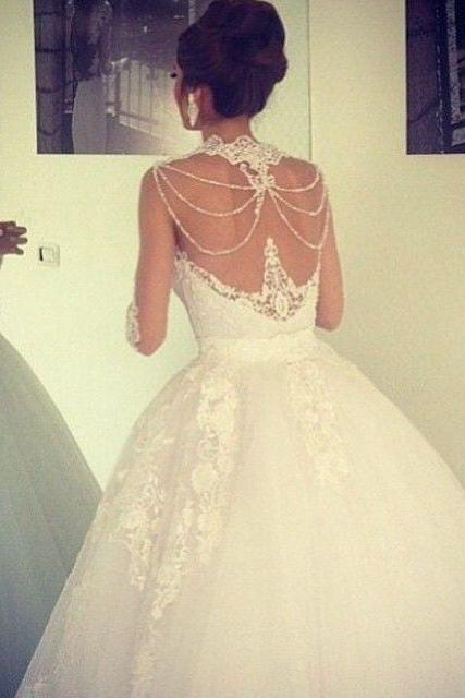 Stunning Lace Appliqued Wedding Dresses Ball Gown Sheer Jewel Neckline Illusion Beading Back Long Sleeves Sweep Train Tulle Bridal Gown